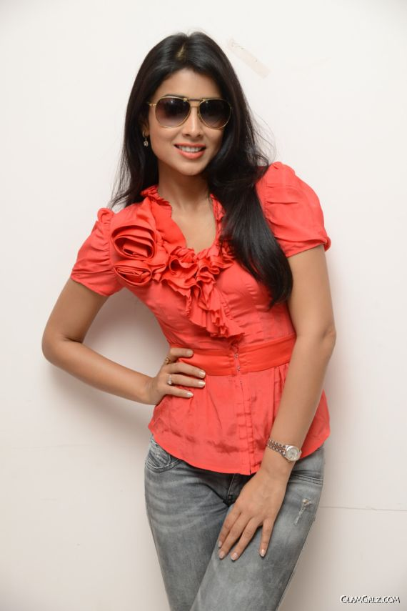 Shriya Saran Looks Gorgeous In Red Top Jeans